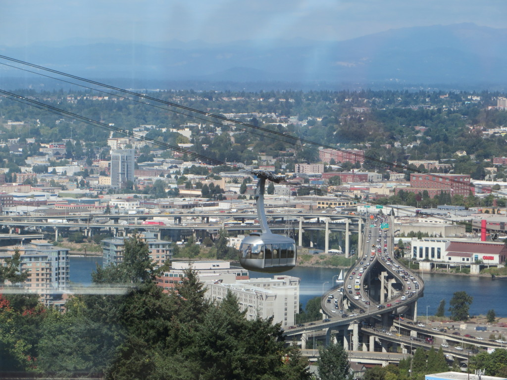 View from the Tram Car of the other Tram Car with Portland in the background.