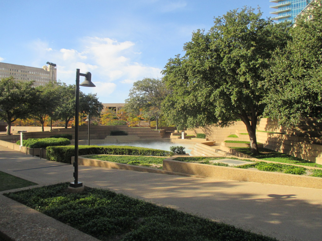 Grounds of Fort Worth Water Gardens - note building in background upper left